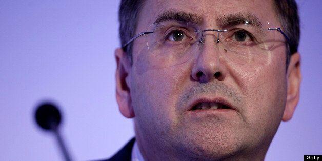 Philip Clarke, chief executive officer of Tesco Plc, listens during the British Retail Consortium's (BRC)...
