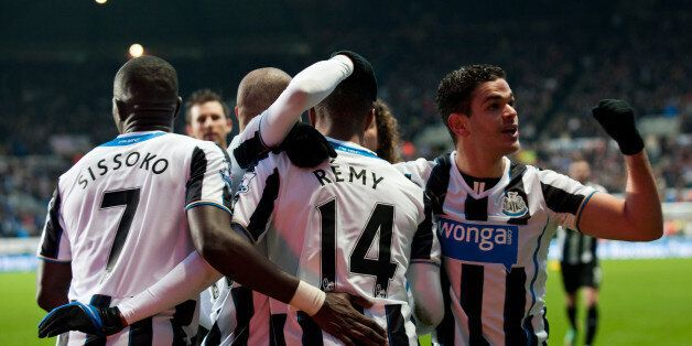 NEWCASTLE, ENGLAND - DECEMBER 26: Newcastle United players Hatem Ben Arfa (R) and Moussa Sissoko (L)...