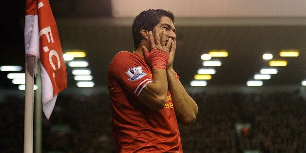 LIVERPOOL, ENGLAND - DECEMBER 04: (THE SUN OUT, THE SUN ON SUNDAY OUT) Luis Suarez of Liverpool celebrates...