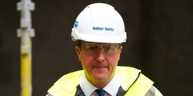 Prime Minister David Cameron during a visit to a construction site in central London before travelling...
