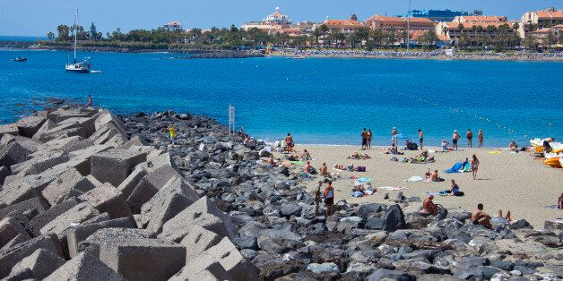 TENERIFE, SPAIN - MARCH 25: Wave breakers and artificial reefs at the beach of Los Cristianos, Costa...