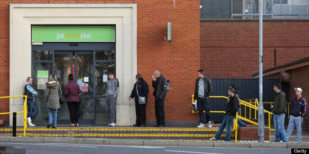 Jobseekers queue outside a job centre plus in Great Yarmouth, U.K., on Tuesday, Oct. 9, 2012. U.K. Chancellor...