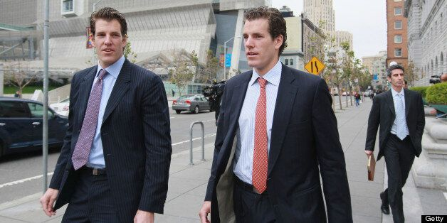 SAN FRANCISCO - JANUARY 11: Cameron (C) and Tyler Winklevoss (L) leave the U.S. Court of Appeals on January...