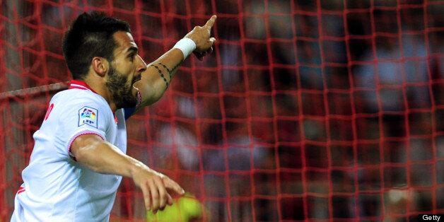 Sevilla's forward Alvaro Negredo reacts during the Spanish league football match Sevilla FC vs Atletico...