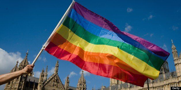 A protestor holds a rainbow flag outside the Houses of Parliament in central London on June 3, 2013,...