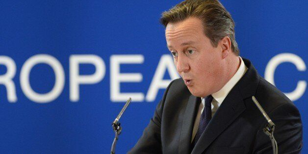 British Prime Minister David Cameron gives a press conference after an EU summit focused on the common...