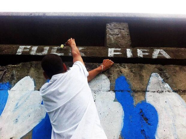 World Cup 2014: 14 Powerful Pictures Of Anti-Fifa Graffiti In