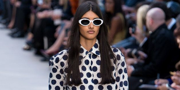 LONDON, ENGLAND - SEPTEMBER 16: Model Neelam Johal walks the runway at the Burberry Prorsum show at London Fashion Week SS14 at Kensington Gardens on September 16, 2013 in London, England. (Photo by Ian Gavan/Getty Images)