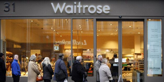 Customers queue outside the first Waitrose convenience store, which opened today on Trinity Square in