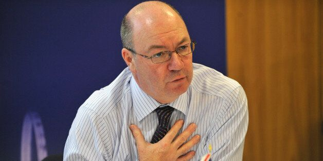 British Foreign Office Minister for the Middle East and North Africa Alistair Burt gestures during a...