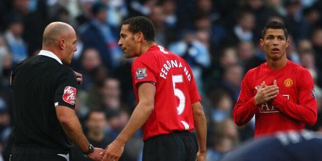 MANCHESTER, UNITED KINGDOM - NOVEMBER 30: Rio Ferdinand protests to Referee Howard Webb as Cristiano...