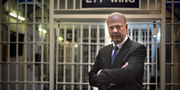 Embargoed until 0001 Tuesday 30th April. Justice Secretary Chris Grayling during a visit to Pentonville...
