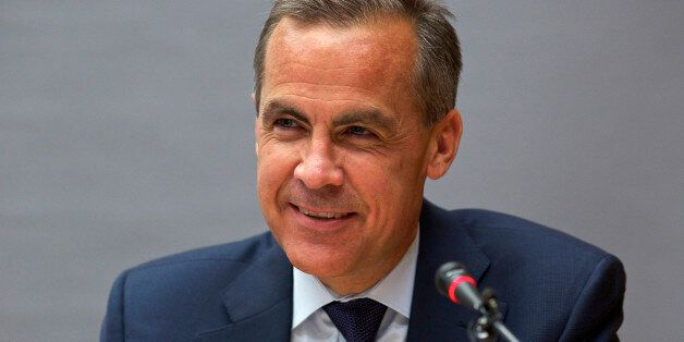 FILE PHOTO: Mark Carney, chairman of the Financial Stability Board (FSB), speaks during a news conference...