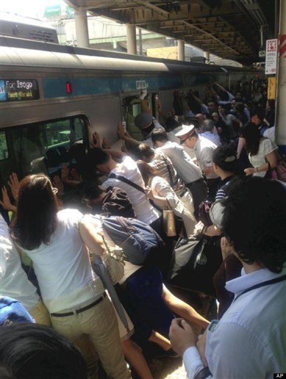 Japanese Passengers Push Train To Rescue Woman Stuck On Tracks Near Tokyo