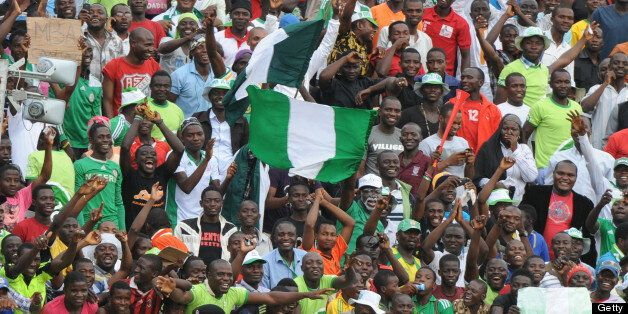 Nigerian players celebrate with the crowd after their 2014 African Nations Championship (CHAN) qualification...