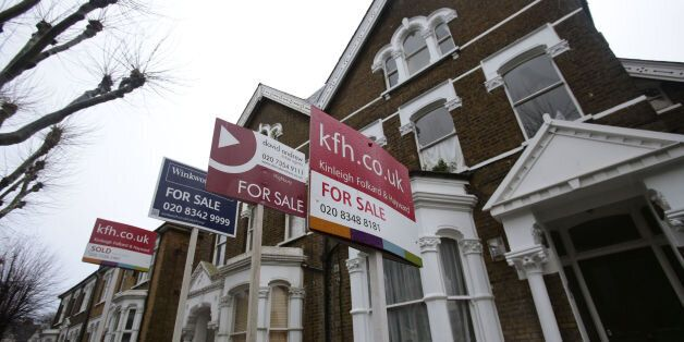 File photo dated 27/01/14 of For Sale signs displayed outside houses in Finsbury Park, north London,...