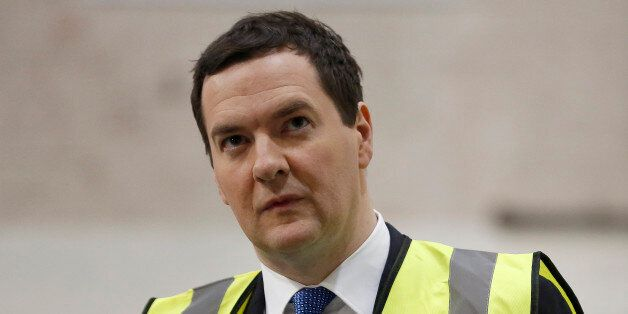 George Osborne, U.K. chancellor of the exchequer, pauses during a tour of Sertec Group Holdings Ltd.'s...