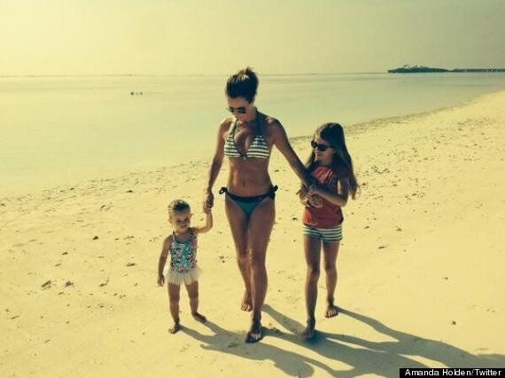 Amanda Holden Shows Off Beach Body As She Posts Family Holiday Picture On