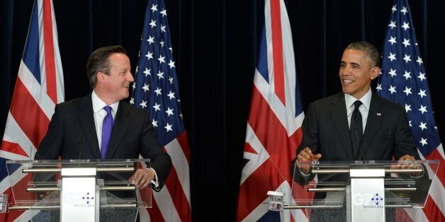 British Prime Minister David Cameron (left) holds a press conference with US President Barack Obama during...