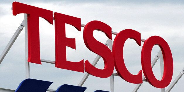 File photo dated 01/08/12 of a Tesco sign as the supermarket chain reported a fresh dip in quarterly