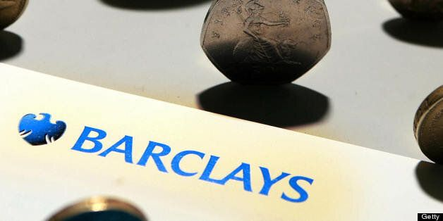A Barclays bank leaflet is pictured with coins in London, on August 7, 2008. British bank Barclays said...