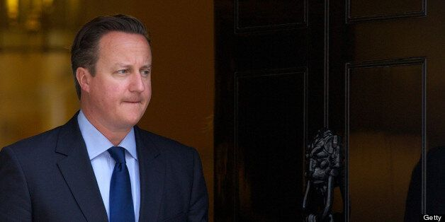 British Prime Minister David Cameron waits for the arrival of Emirati Crown Prince of Abu Dhabi Mohammed...