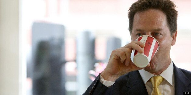 Deputy Prime Minister Nick Clegg drinks a coffee at the Olive Delicatessen in Manchester city