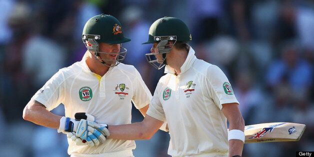 MANCHESTER, ENGLAND - AUGUST 01: Michael Clarke (L) of Australia shakes hands with Steve Smith as they...
