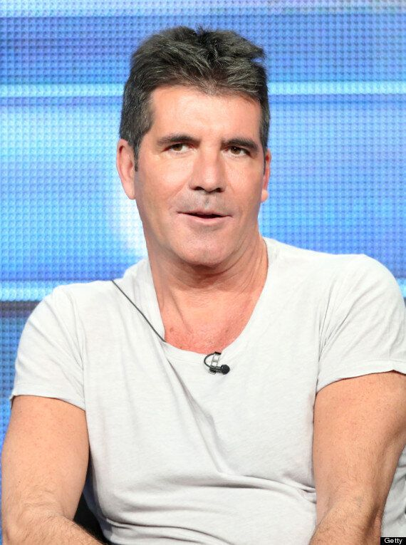 Simon Cowell Baby: Music Mogul Jokes He 'Hasn't Read The Newspapers' As He's Questioned About Lauren...