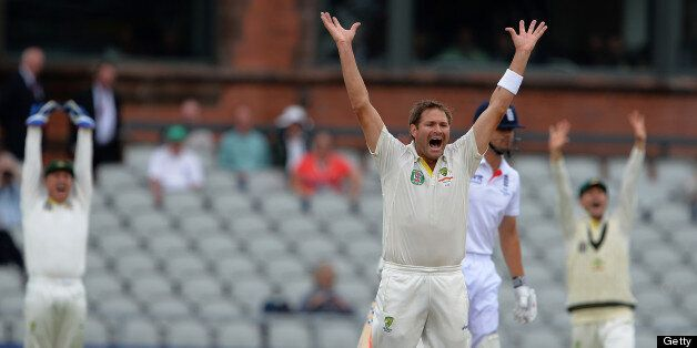 Australia's Ryan Harris (3rd R) celebrates after claiming the wicket of England's Alastair Cook (2nd...