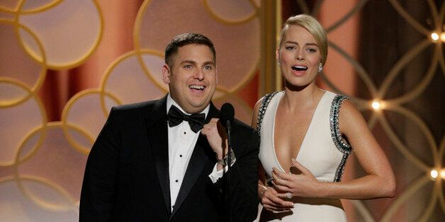 Presenters Jonah Hill and Margot Robbie speak onstage during the 71st Annual Golden Globe Award at The...