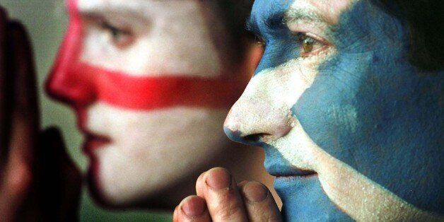 Edinburgh football fans Mark Roberts (right) and David Johns hope for the best for their teams, in the...