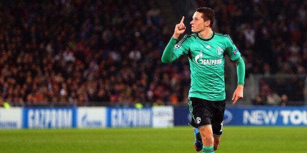 Schalke's midfielder Julian Draxler celebrates after scoring during the UEFA Champions League group E...
