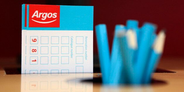 Product order forms and pencils sit on display at an Argos store, operated by Home Retail Group Plc,...