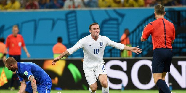 MANAUS, BRAZIL - JUNE 14: Wayne Rooney of England reacts towards the referee during the 2014 FIFA World...