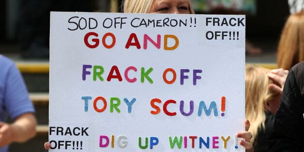 Anti-fracking protesters outside as Prime Minister, David Cameron visited the Wigan Youth Zone boys and...