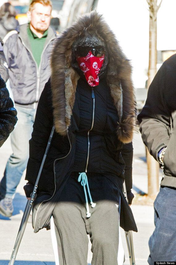 Madonna Keeps Covered Up As She Heads To The Gym On Crutches After Injuring Her Foot