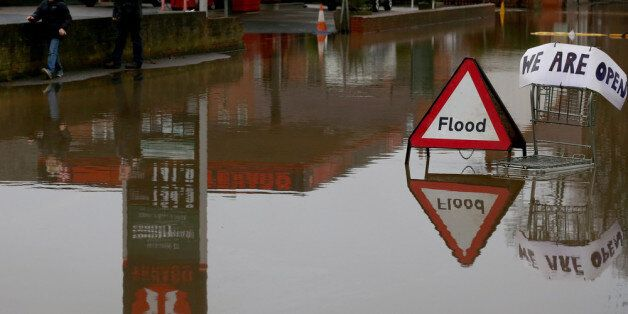 UPTON UPON SEVERN, UNITED KINGDOM - JANUARY 04: A flood sign warns besides a petrol station close to...