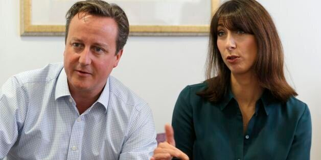 Prime Minister David Cameron and his wife Samantha talk to cancer patients during a visit to the John...
