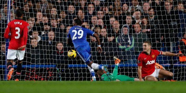 Chelsea's Cameroonian striker Samuel Eto'o (C) scores their second goal past Manchester United's Spanish...