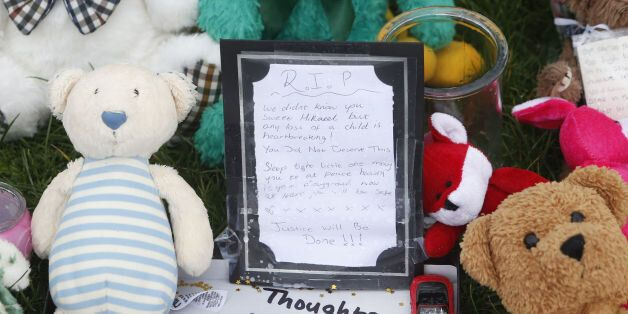 Tributes are left at Ferry Gait Crescent in Edinburgh, Scotland, near the home of three year old Mikaeel...