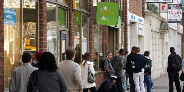 LONDON, ENGLAND - MARCH 18: Job seekers queue outside a Jobcentre Plus branch in London Bridge on March...