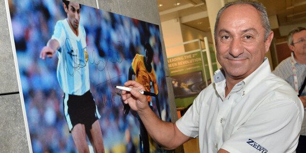 MONACO - OCTOBER 16: Osvaldo Ardiles signs a picture prior to the Golden Foot Award press conference...