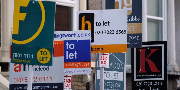 Estate agents boards are seen in Lambeth,