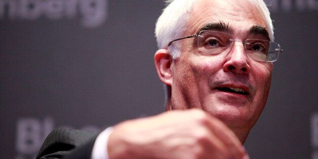 Alistair Darling, former U.K. chancellor of the exchequer, gestures during the Sovereign Debt Briefing...