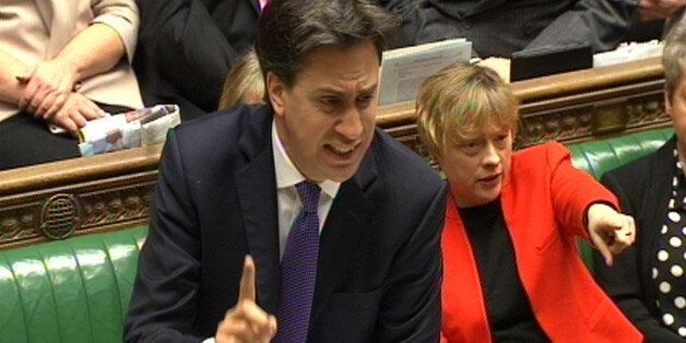 Labour party leader Ed Miliband speaks as Angela Eagle points during Prime Minister's Questions in the...