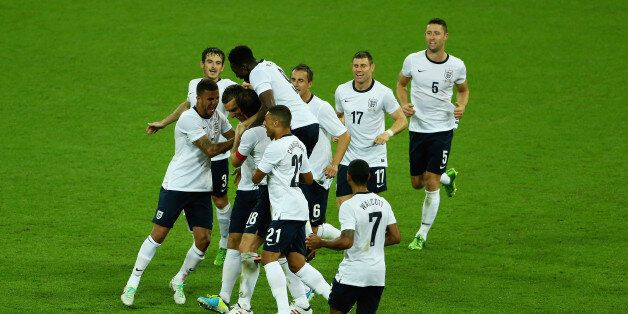 LONDON, ENGLAND - AUGUST 14: Rickie Lambert of England is congratulated on his goal during the International...