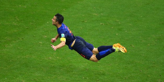 SALVADOR, BRAZIL - JUNE 13: Robin van Persie of the Netherlands scores the team's first goal with a diving...