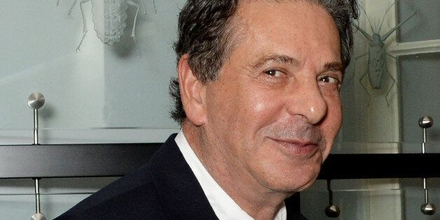 Charles Saatchi has challenged a Spectator columnist to a cage