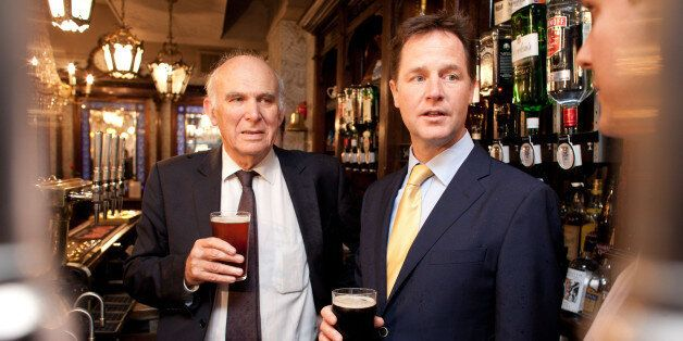LONDON - JUNE 3: Deputy Prime Minster Nick Clegg shares a pint with Business Secretary Vince Cable, at...